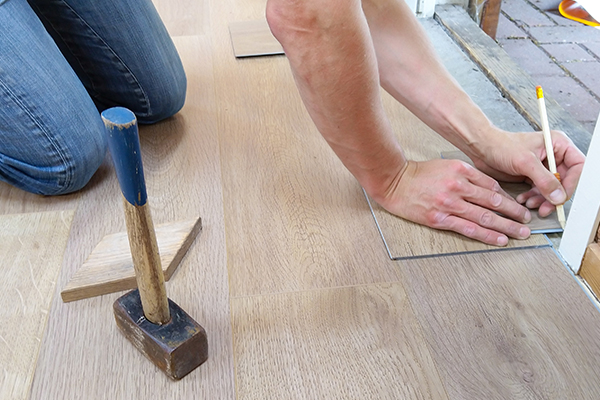 An image showing us measuring the flooring for a door frame