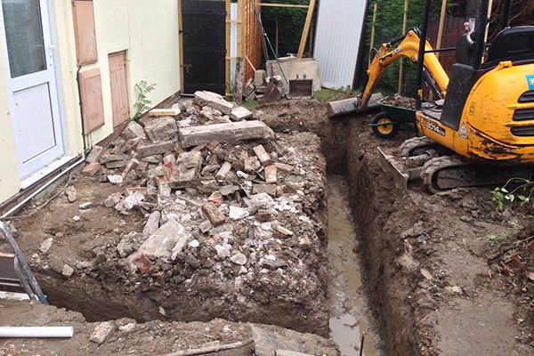 An image of some house foundations being dug